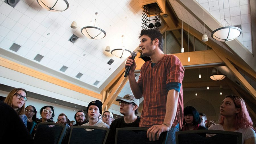 A student asks a question during Suresh Garimella only visit to campus Feb. 14 before he was approved to be the next University president. Garimella was the sole finalist from the presidential search presented to the public, but there were two interviewed by the faculty panel.