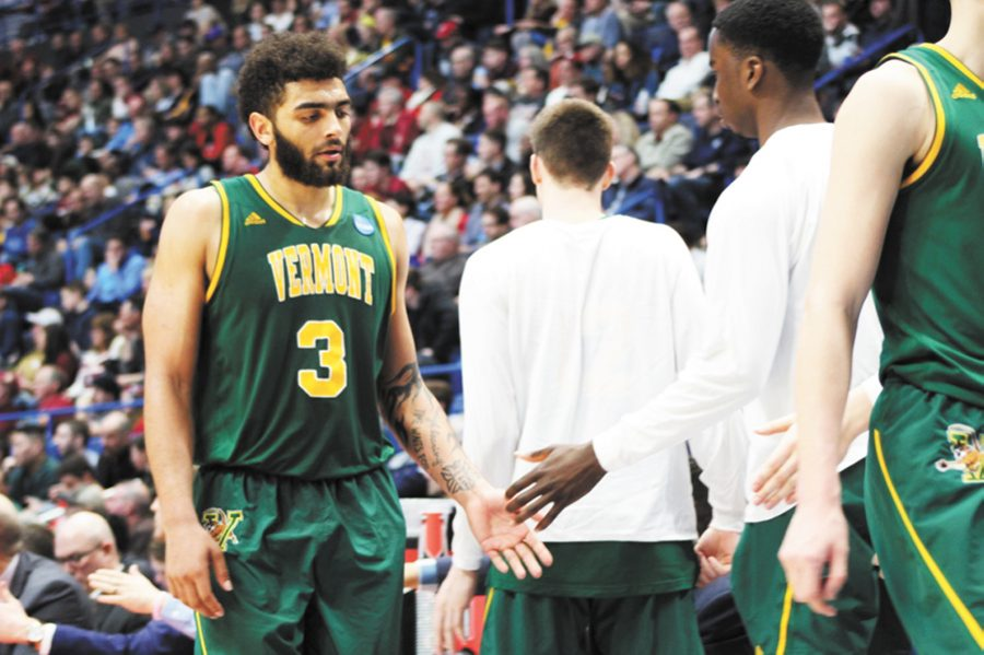 Anthony Lamb makes his way to the bench as Florida State makes a UVM win seem unreachable in the final minutes of the game March 21.