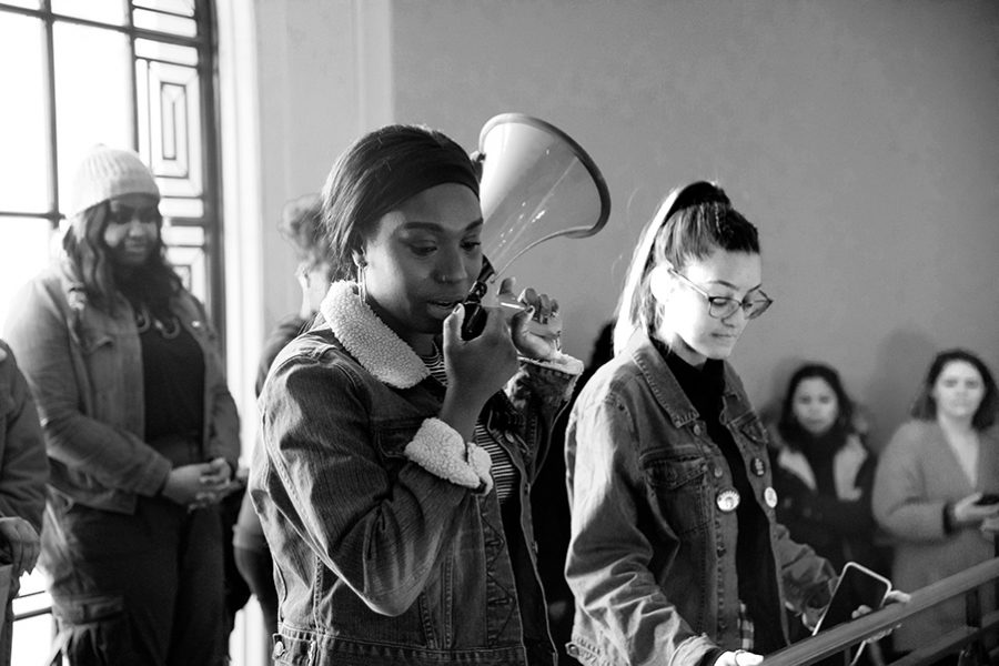 Sophomore+Harmony+Edosomwan%2C+a+leader+of+the+student+group+NoNames+for+Justice%2C+speaks+to+the+crowd+alongside+junior+Amanda+Martinez+Feb.+26.+The+rally+commemorated+the+one-year+the+one-year+anniversary+of+the+group%27s+Waterman+takeover.+