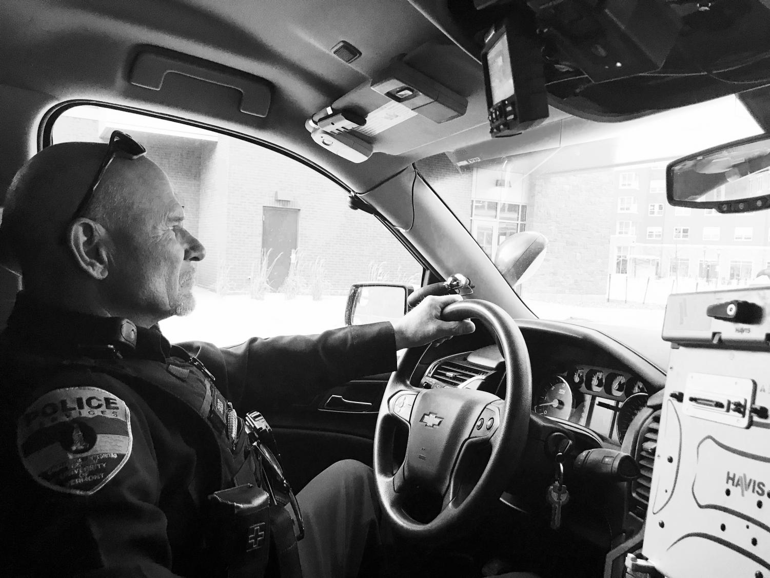 Officer Bill Scioss of UVM police services patrols the campus looking for suspicious activity. UVM police officers respond to emergency calls on campus, but also perform daily safety walkthroughs of buildings and support on-campus events.