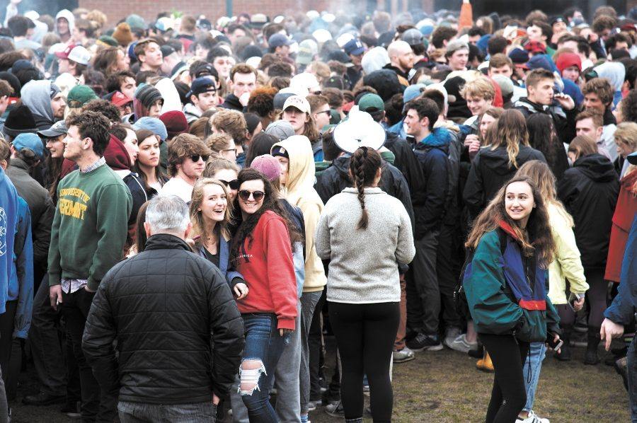 UVM police services watch over the crowd of students gathered on Redstone campus for the 4/20 celebration April 20.
