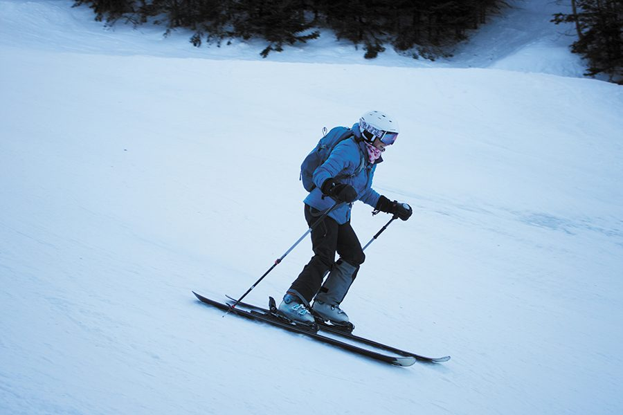 Senior Meghan Driscoll smiles while skiing down the mountain March 20.