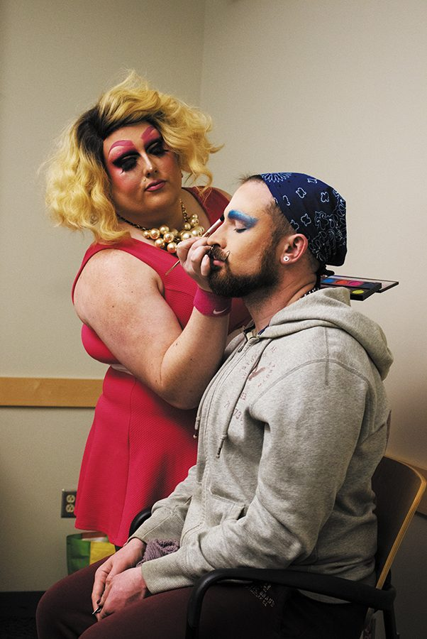 Drag queen Emoji Nightmare demonstrates the essentials of drag makeup on a willing volunteer April 4 at the Queer Student Union's Feeling the Fantasy Makeup tutorial. The tutorial was the second event in a four-part Drag WERKshop series.