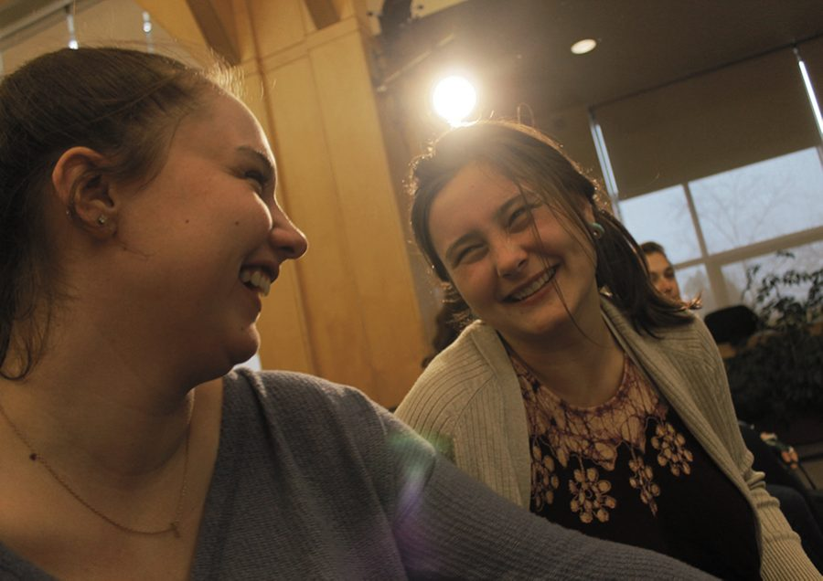 """Sophomores Julia Roy and Callie Kotzan share a laugh April 3 at UVM Program Board's April Fool's Day Comedy show featuring comedian Rachel Feinstein. """"I got married awhile ago, and being a wife hasn't made me any more responsible,"""" Feinstein said. """"I'm still an animal. I lose a debit card a week."""""""