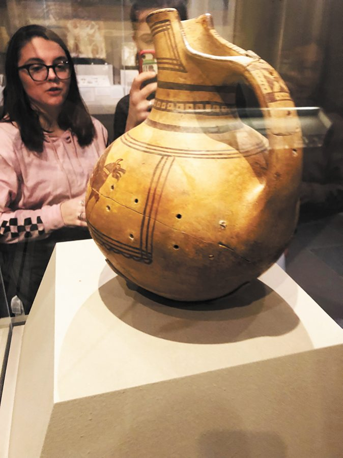 "UVM students who attended a field trip to the Museum of Fine Arts in Boston admire an ancient vase. ""The art department, classics department and the classics club all threw money at the trip to make sure it could happen,"" associate classics professor Angeline Chiu said."