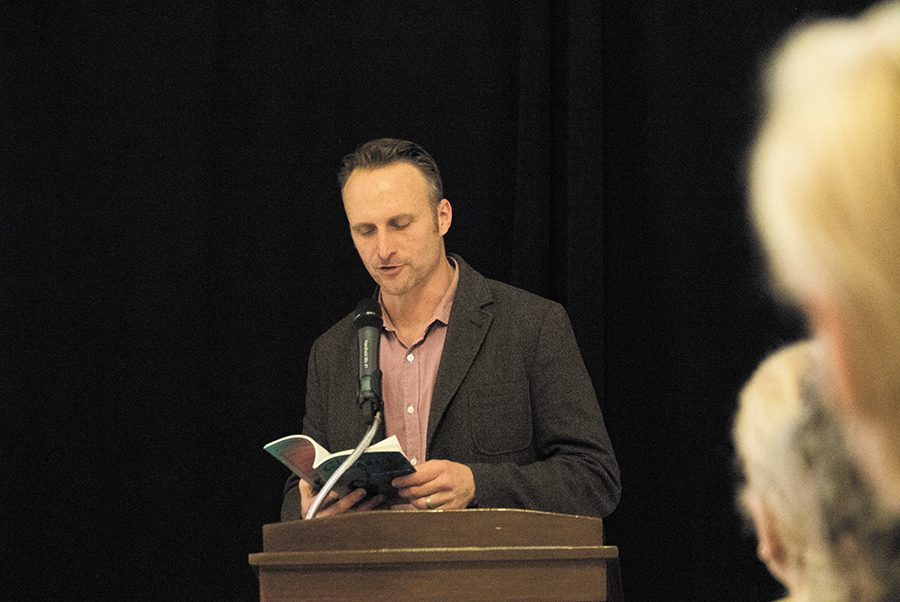 Poet Matt Miller reads his poetry to an audience  April 22 in the Fleming Museum. Miller's poetry comes mostly from a parent's perspective. He spoke about the horror of losing a child, the need to protect your kids and the happiness of parenting.