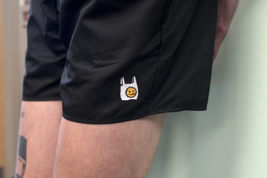 Senior Sammy Hedlund poses in his hand-designed shorts April 7. Though the shorts are currently sold out, Hedlund says he's planning on two more drops of product before the summer is over.