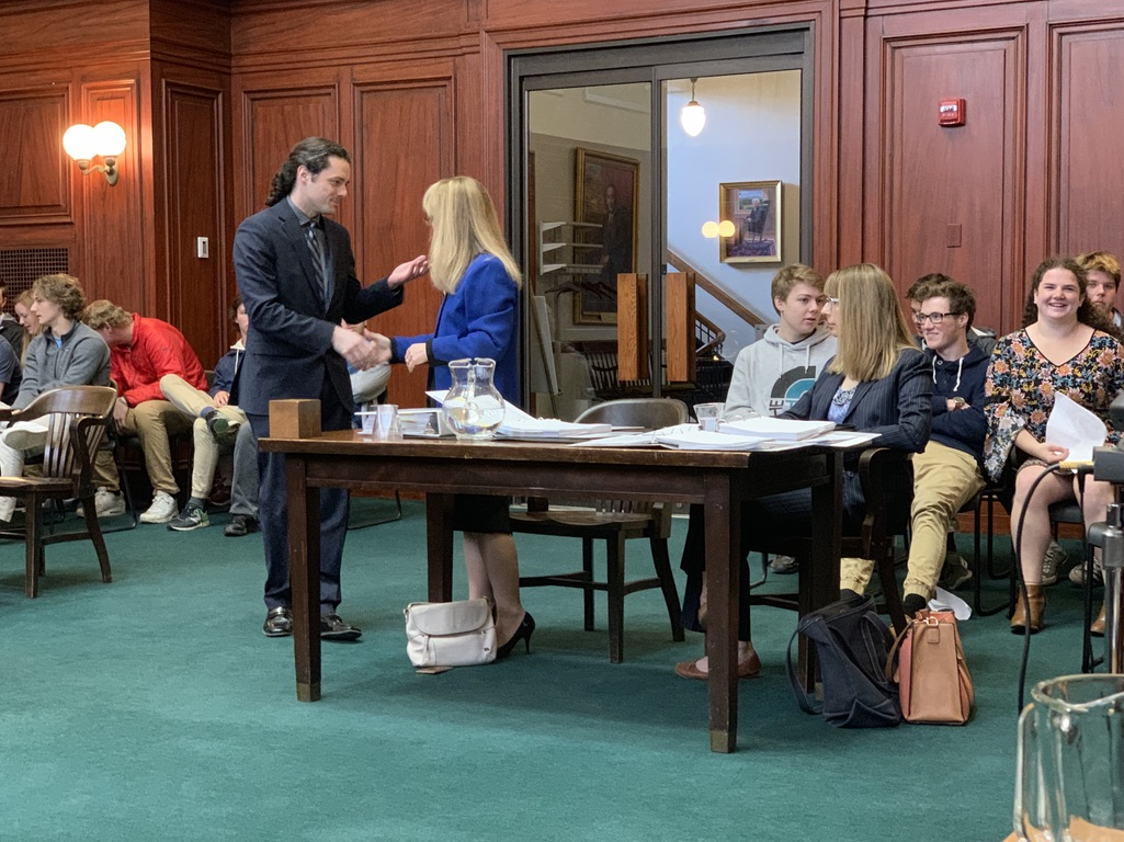 Jacob Oblak (left) shakes hands with UVM's General Counsel Sharon Reich Paulson (right) just before their case is heard in front of the Vermont Supreme Court.