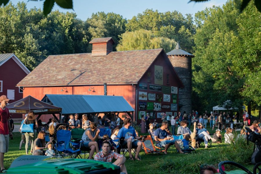A crowd of people gather in front of the Intervale Center Community Barn for the Summervale Festival, Aug. 29.