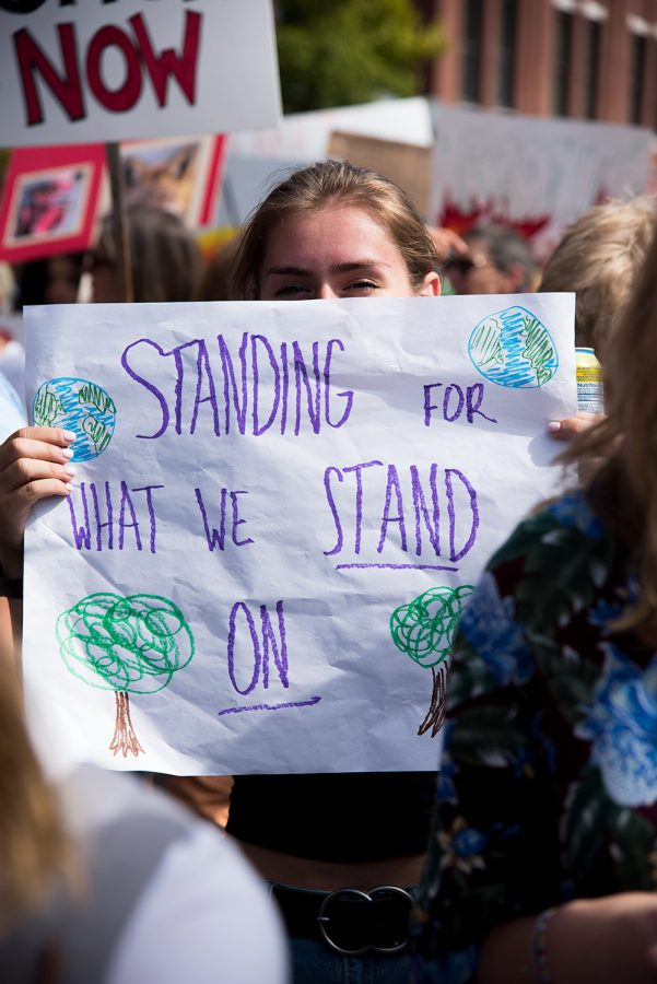 A student stands among countless others during the worldwide climate change protest, Sept. 20.