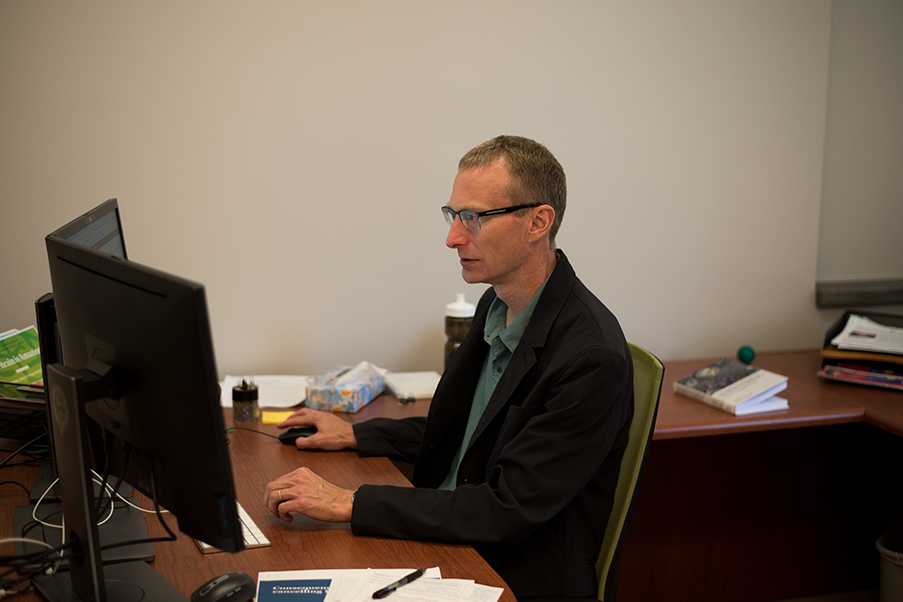 Dean of Libraries Bryn Geffert works in his office in Howe Library, Sept. 13. Even after entering the world of libraries, Geffert never saw himself as a library director.