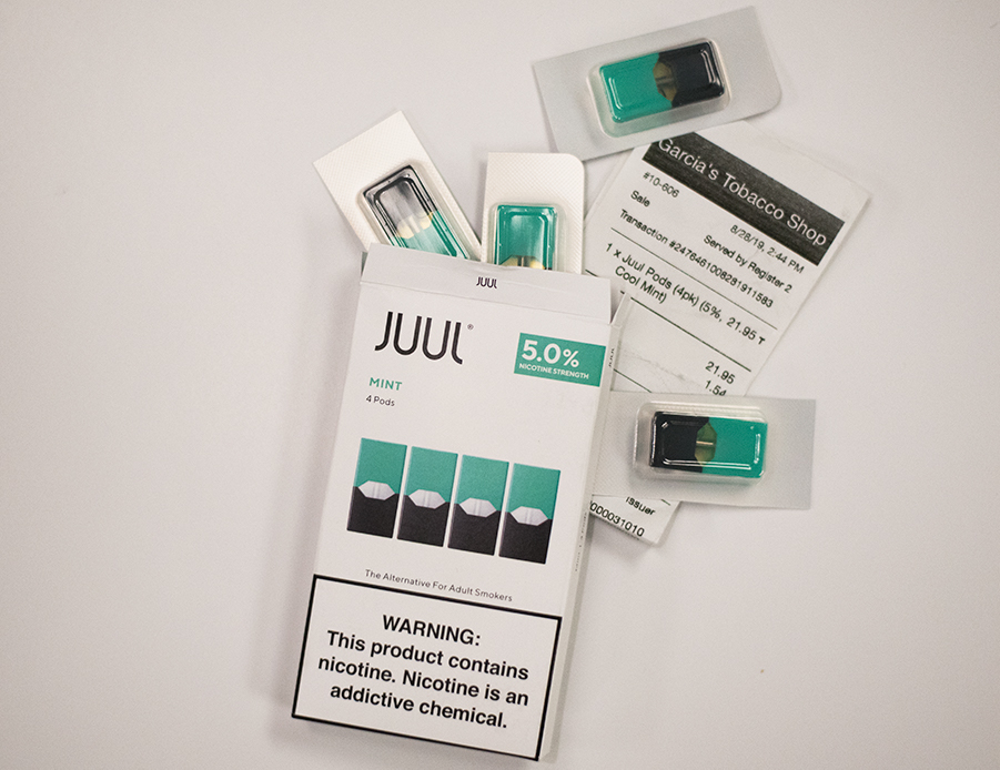 "Mint Juul pods from Garcia's Tobacco Shop on Church Street spill out of the box. ""There's really been an epidemic in vaping, specifically Juuling, among high schoolers, and high schoolers coming into college,"" said Parker Holloway, program coordinator of Living Well."