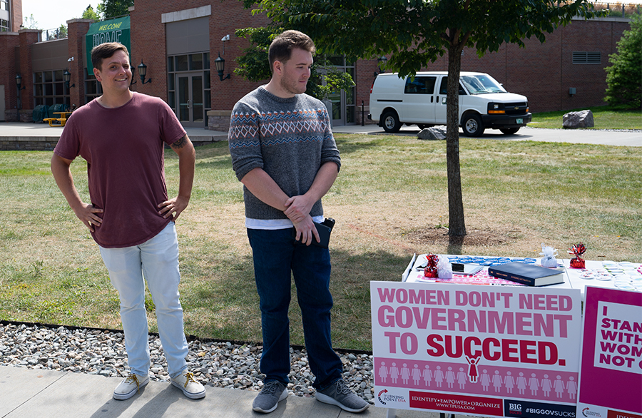 Two self-identifying Turning Point USA representatives, one wearing a body camera, table on the Andrew Harris Commons, Aug. 27. Although they are an SGA recognized group, SGA President Jillian Scannell said the group has not done any of the SGA requirements that all recognized groups must do.