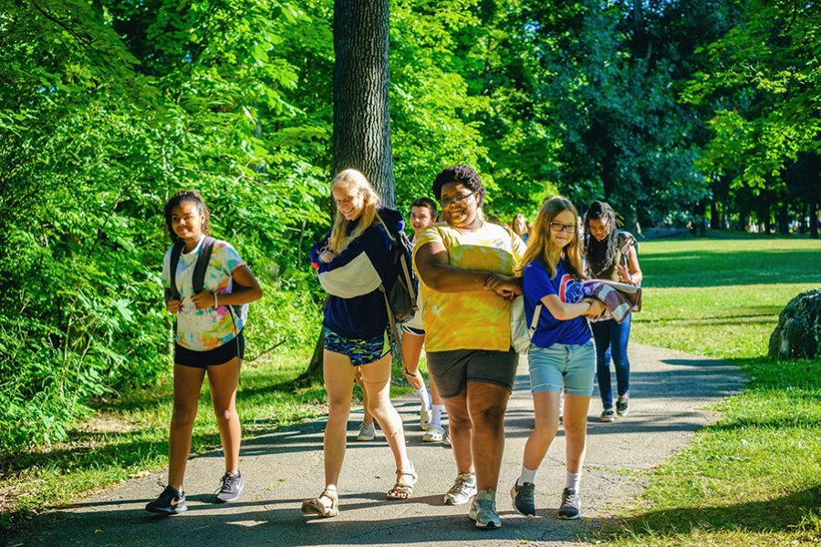Sophomore Kelsey Deemer walks with both her campers and a fellow counselor at a summer camp in Brookston, Indiana in July. Deemer spent nine weeks sleeping in a cabin with 13-14 year old girls and doing activities such as spa nights, ropes courses and boat races this summer.