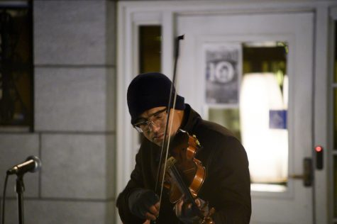 The artist known as DBR performs at 1 a.m. Oct. 27 in front of Burlington City Hall. His performance was part of a 24-hour demonstration meant to call attention to U.S. immigration policy.