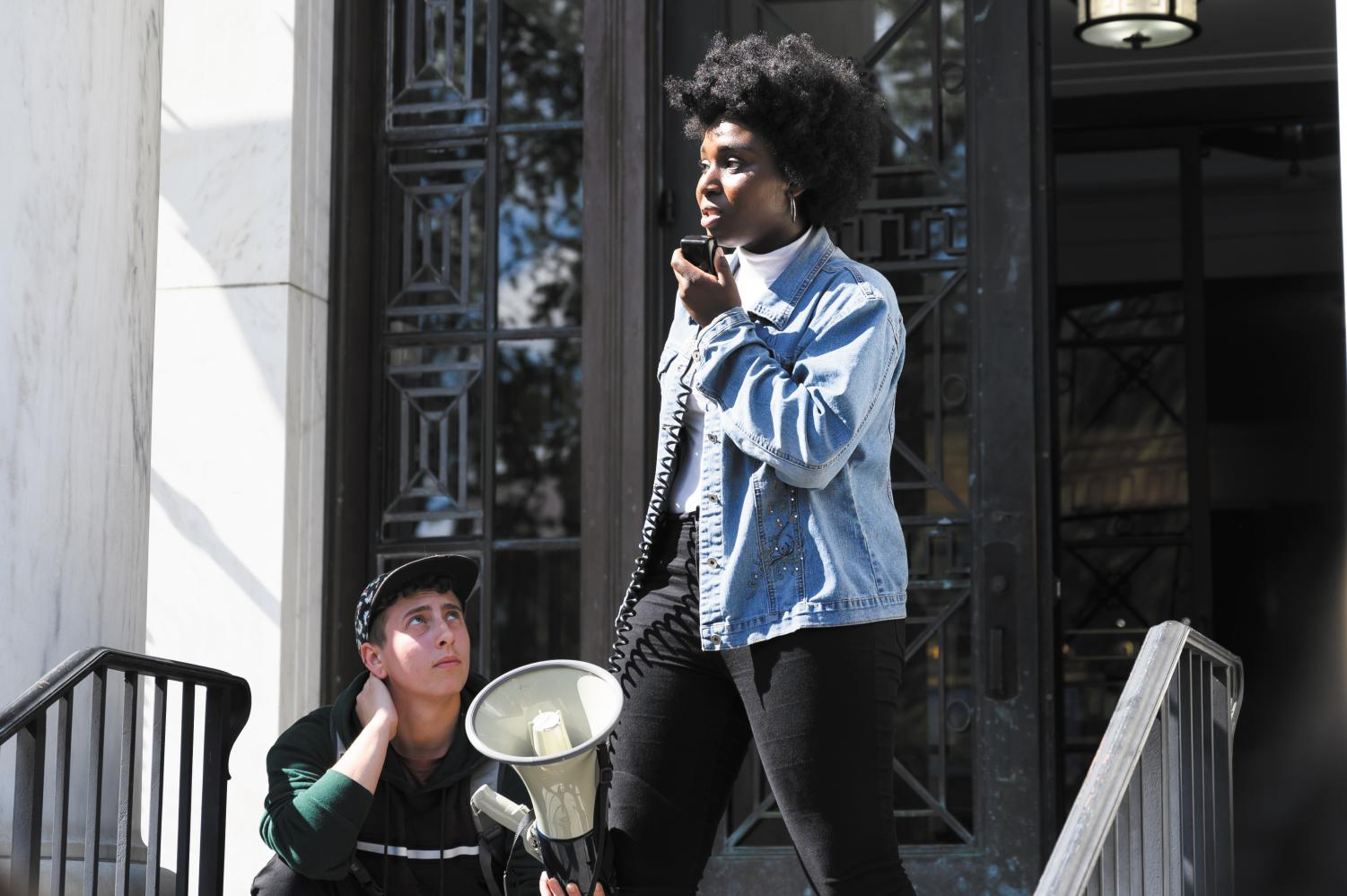 Senior Harmony Edosomwan speaks during a protest organized by NoNames for Justice and Queer Student Action at Waterman building, Sept. 25. The protest called for the release of the complete Campus Climate Survey data from the University.