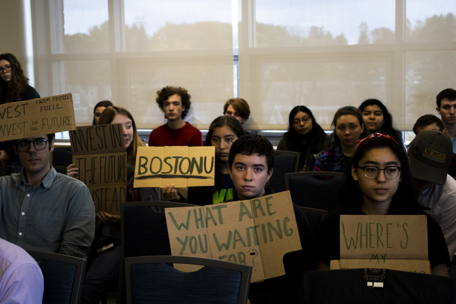 Students protest silently during a board of trustees meeting in Livak Ballroom, Oct. 26. The meeting was one of several that took place over the course of Oct. 25-26.