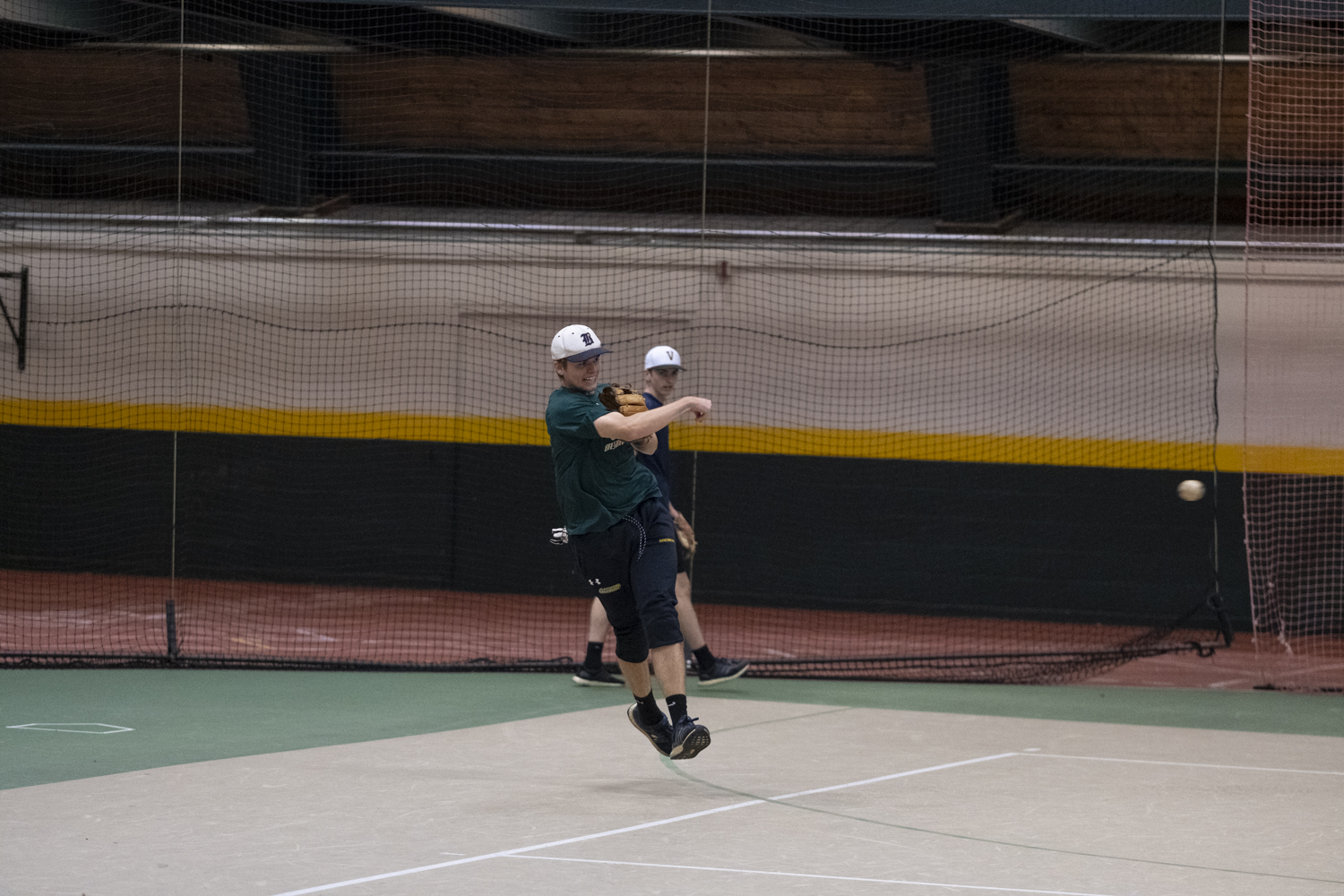 Junior Pat Brennan throws a baseball in midair during a club baseball practice, Oct. 17. Brennan is one of the 18 members of the team, according to UVM Clubs.