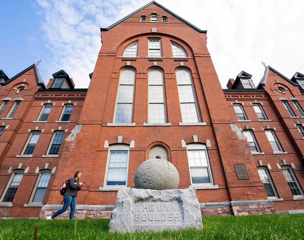 The UVM boulder sits on its base outside Old Mill, Oct. 11. The boulder, being perfectly round, symbolises well-roundedness at the University.