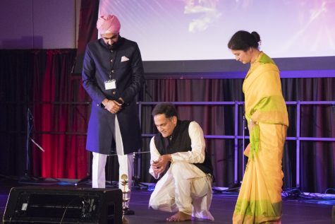Suresh Garimella (Kneeling) and his wife Lakshmi light the ceremonial lamp that signifies the start of Diwali, Oct. 27. This year's celebration falls on the exact day of Diwali.