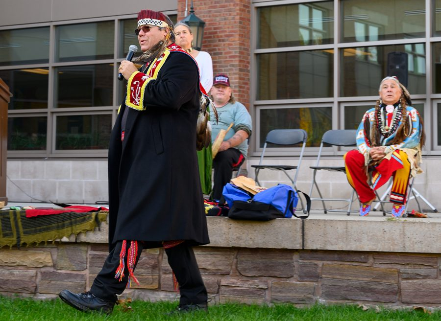 Abenaki Chief Don Stevens introduces the healing ceremony before performing it. In addition to the celebrations on the Davis Center green, there were workshops in different places around campus.