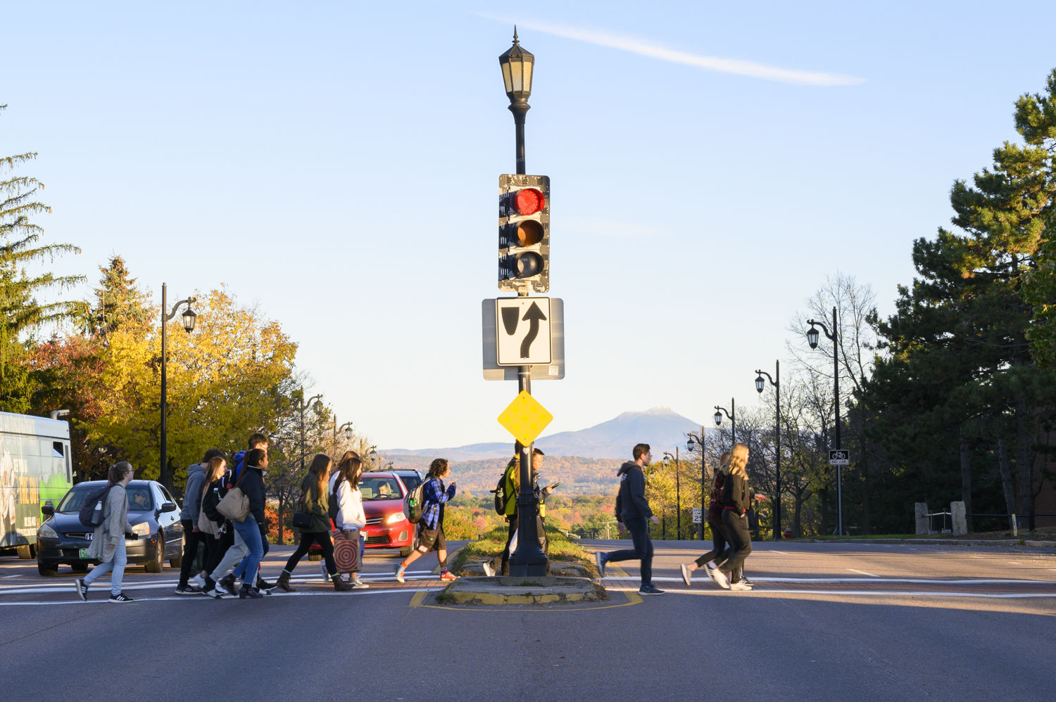 Pedestrians cross Main Street at the corner of University Heights, Oct. 19. The intersection is among the busiest in Vermont.