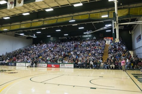 Fans fill the bleachers of Patrick Gym to watch the ceremony and men's basketball exhibition game against Brown University. UVM won the game 70-59.