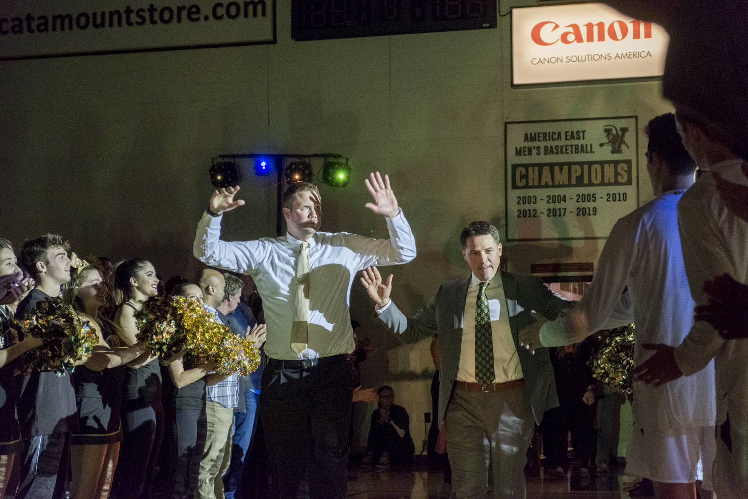 Coppenrath (Left) and Sorrentine (Right) walk into Patrick Gym to cheering and applause. In addition to having their jerseys retired, the two former Catamounts were inducted into the UVM Hall of Fame in 2015.