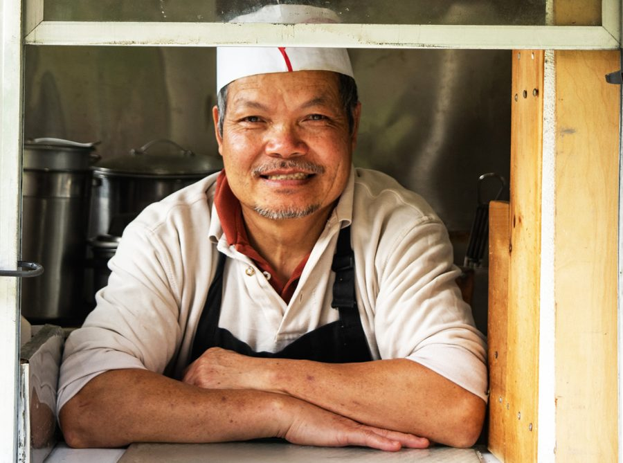 Lap Ninh, owner and operator of Lucky Chinese Food, poses in his truck, Oct. 1. Ninh has been operating the truck for the past 27 years.