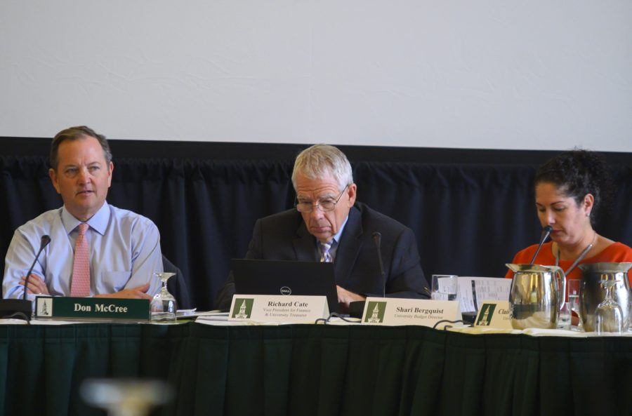 (left to right) Trustee Don McCree, VP of Finance Richard Cate and University Budget Director Shari Bergquist sit at the Oct. 26 board of trustees meeting.