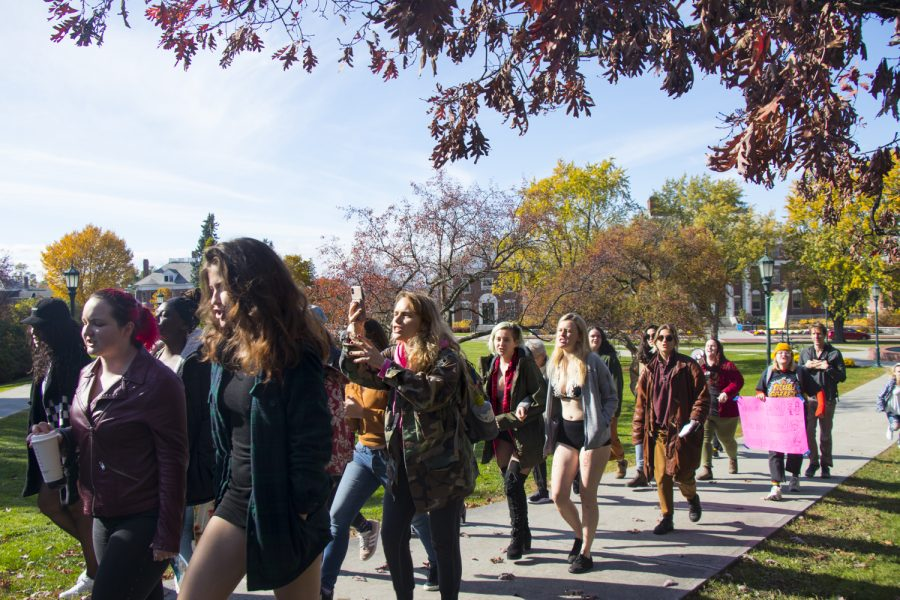 Students walk from Waterman building to the Living/Learning Center Fireplace Lounge, Oct. 26. The walk was the third annual SlutWalk, which calls attention to domestic violence, sexual assault and gender inequality.