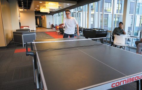First-year Levi Putman returns a volley during a warmup match, Sept. 19. The club now meets in Mann Hall instead of the Redstone Lofts and practices on three tables instead of one.