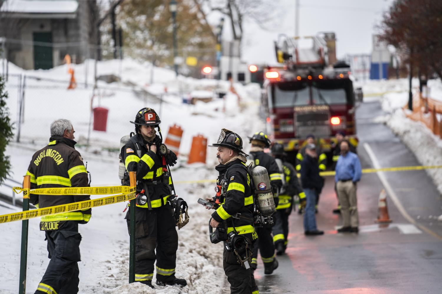 Firefighters stand outside Innovation and Discovery Halls Nov. 15. A chemical fire in a lab closed the two buildings down all day Friday.
