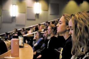 Students sit close to one another, maskless, in a lecture hall prior to the COVID-19 pandemic November 2019.