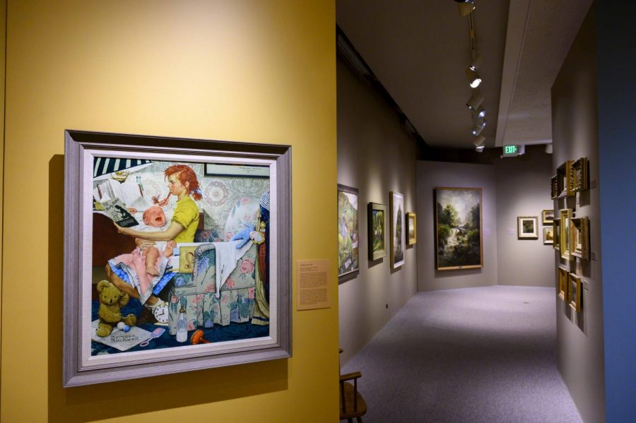 ": ""Babysitter"" by Norman Rockwell basks underneath a spotlight in Fleming Museum's Gallery of European and American art, Nov. 10."