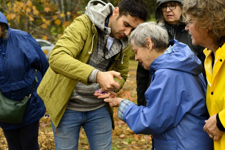 Postdoctoral associate Arash Ghalehgolabbehbahani identifies different parts of the saffron plant, Oct. 31. Judith Allard '67 G '69, who is holding the saffron, is one enrollee of UVM's Osher Lifelong Learning Institute program.