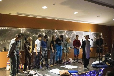 Members of the co-ed a cappella group, Hit Paws, perform in their pajamas in Fleming Museum, Nov. 15. The club is one of five a cappella groups on campus and is one of three gender-inclusive groups.