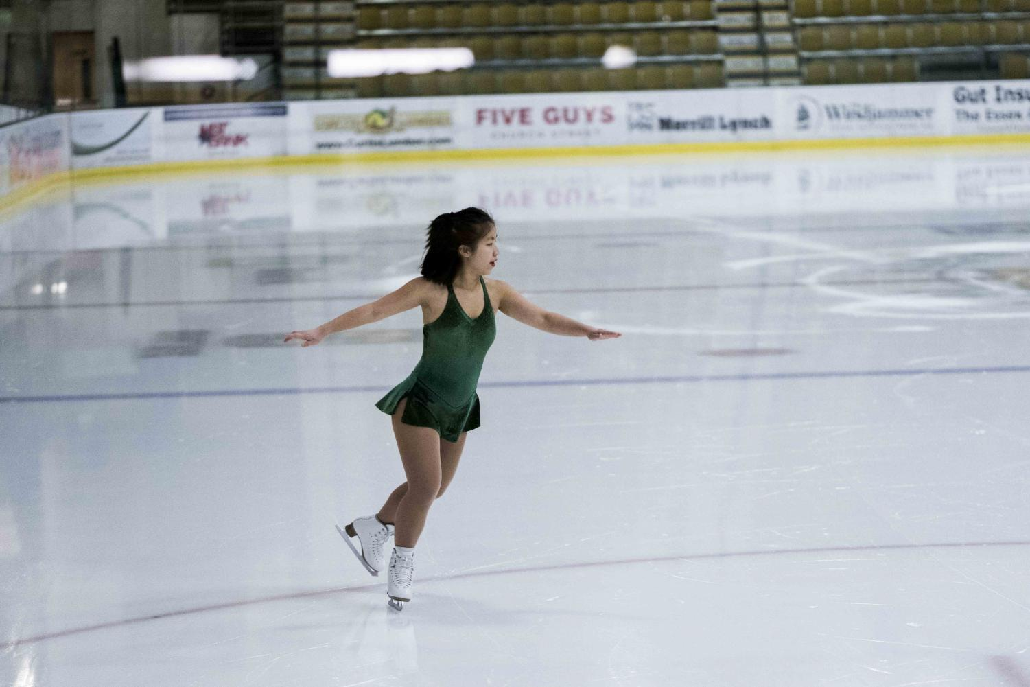 Sophomore Anitra Conover performs as part of the annual UVM Club Sports raffle, Nov.9. Skaters from all the club's teams participated in the show.
