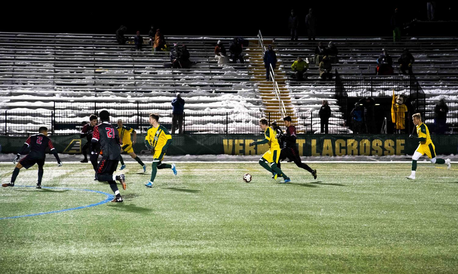 Men's soccer midfielder Joe Morrison, a sophomore, dribbles up the field, Nov. 13. The team lost 3-2 in overtime to Hartford University, ending UVM's season.
