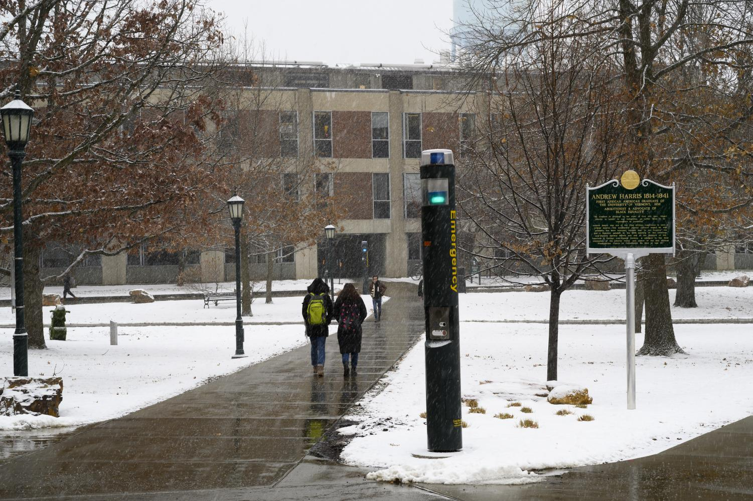 A blue light shines through the falling snow on the Andrew Harris Green, Dec. 6. UVM Emergency Management and SGA President Jillian Scannell, a senior, are currently working to evaluate the use of the lights on campuses nationwide.