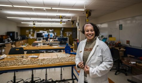 Junior Dia Brown poses in the UVM FabLab, Nov. 20. The FabLab makes rapid-prototyping tools available to UVM students and faculty.