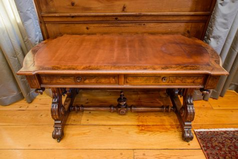 An antique wooden desk first belonging to  Vermont Senator Justin Morrill, author of the Morrill Act of 1862 establishing the country's first land grant universities, sits in President Garimella