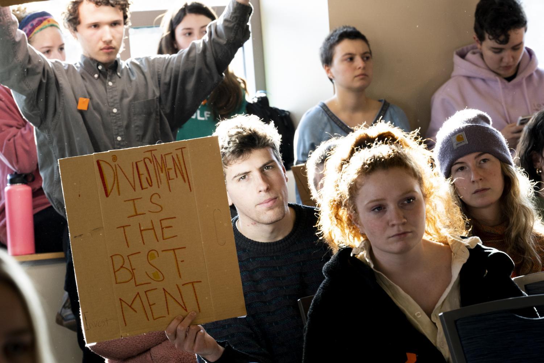 Junior Lowell Deschenes brandishes a sign reading