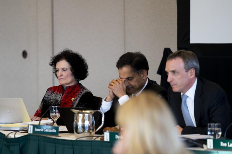 Patricia Prelock, Provost and Senior Vice President, types on her computer during the meeting. President Suresh Garimella (middle), sits with closed eyes, pinching the bridge of his nose.