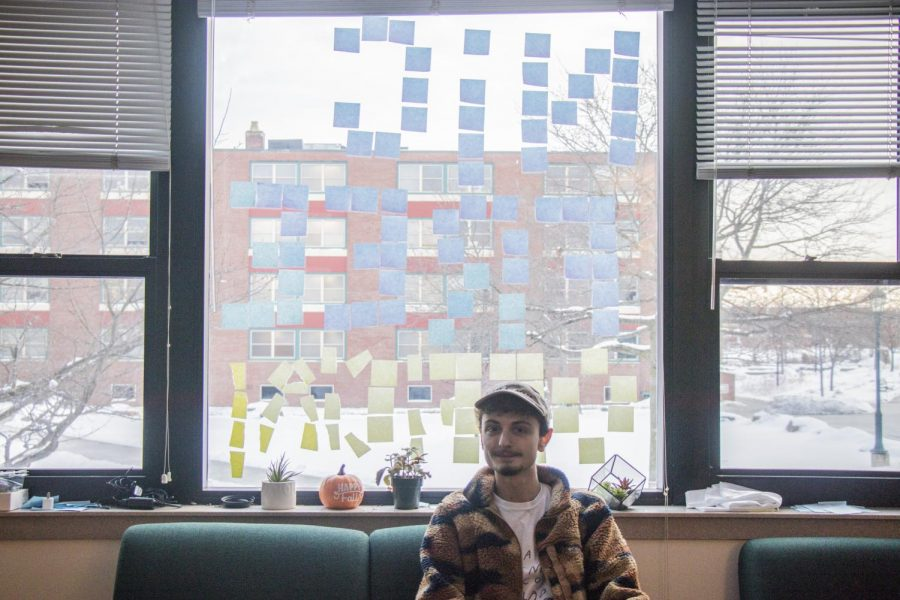 "Sophomore Josh De Velis sits in front of his window of sticky notes that reads, ""Nic Free Official,"" Jan. 23. Ninety nine percent of tobacco users start smoking before the age of 26, according to the U.S. Surgeon General."