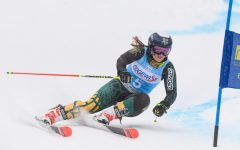 Former student Paula Moltzan skis for UVM during her 2019 season. Moltzan has been on the U.S. Ski team since 2012.