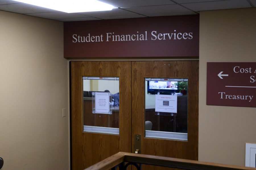 An+employee+of+the+Student+Financial+Services+office+sits+behind+their+desk%2C+Jan.+15.+The+office+is+open+9+a.m.+to+4%3A30+p.m+Monday+through+Friday.+%0A