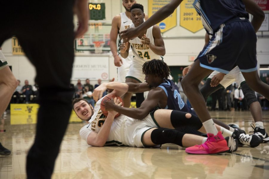 Men's basketball forward Ryan Davis, a sophomore, falls to ground in struggle for the ball during a home game, Feb. 5. The next home game will be against University of New Hampshire Feb. 12.