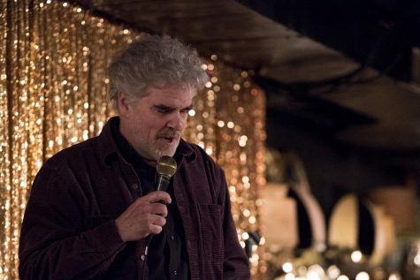 Gordon Clark tells jokes during his set at Death Talks, Jan. 28. Clark was one of a number of performers at the event, which took place at Light Club Lamp Shop.