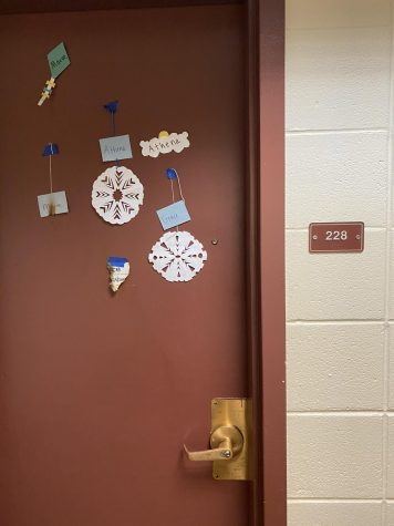 Paper decorations and a notice of room inspections show the lingering marks of fire. Five first-years were charged with arson after setting paper decorations on several doors on fire, according to UVM Police Services.